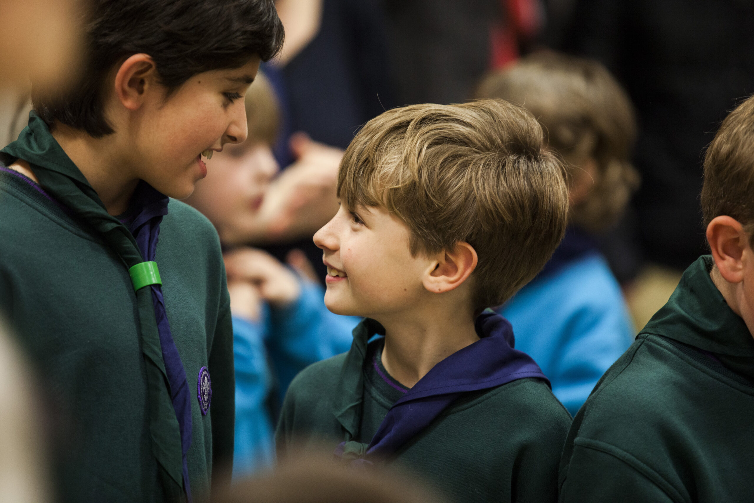Image shows two Cub Scouts chatting